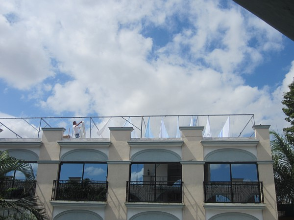 Hanging the hotel sheets to dry