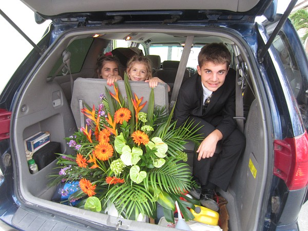 Picking up the flowers that Kelley and Sherri beautifully arranged